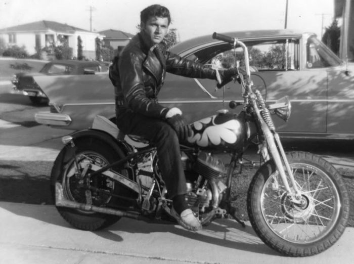Young Dick Dale, Surf Guitar God, looking pretty badass on his 1941 Harley-Davidson Flathead– he even machined the handlebar risers himself.