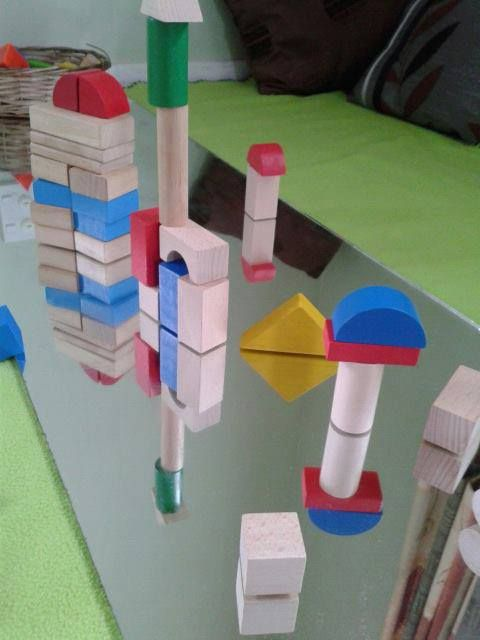 "More symmetry work with blocks a mirror, from 'Tu Tamariki - Play Based Learning' ("",)"