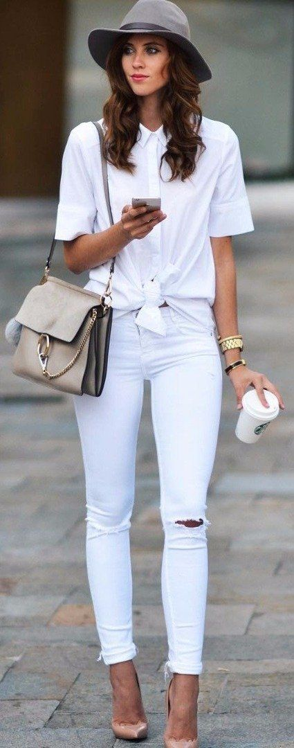 Tie a knot in your tee and pair with jeans for a cute chic day outfit. | Seven Ways to Wear White this Christmas.