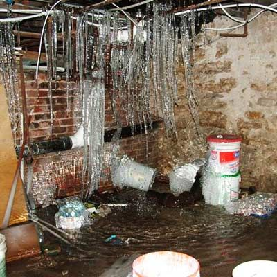 """""""If the buckets aren't sign enough that there's a leakage problem in this basement, perhaps the half foot of standing water and the 5-foot-long icicles will clue you in.""""    Randy Sipe  Family Home Inspection Services, Inc.  Spring Hill, Kan.    thisoldhouse.com 