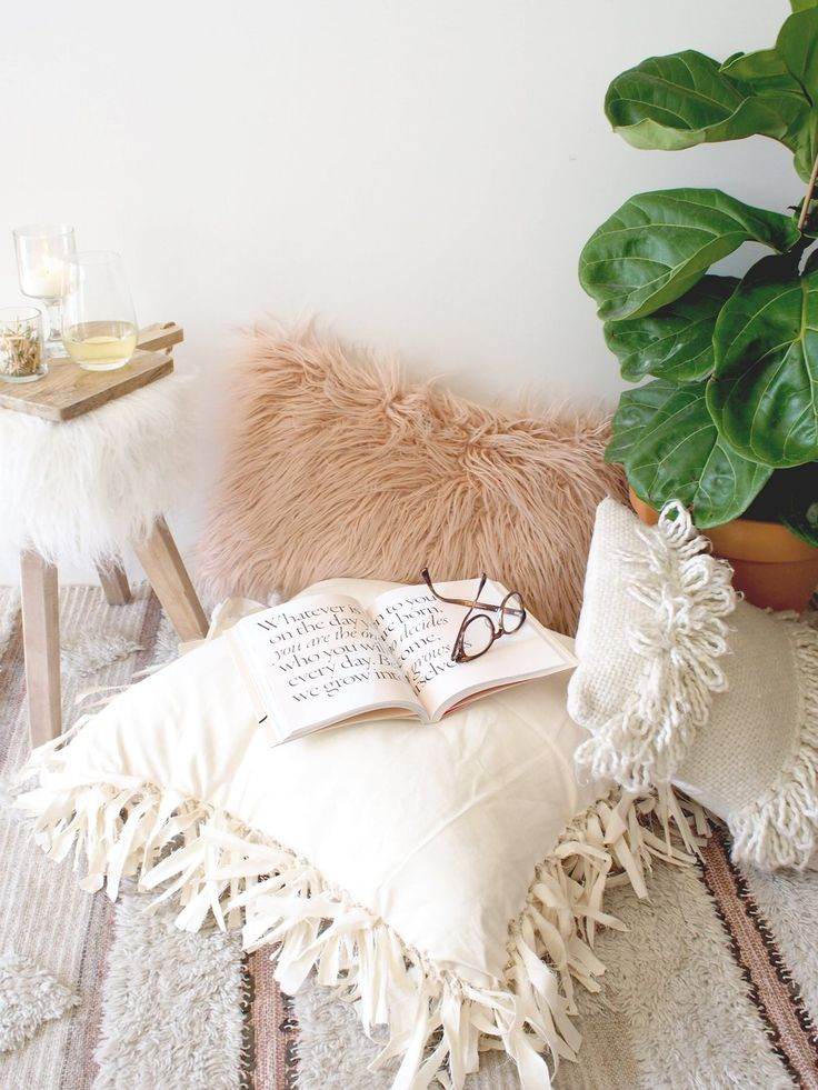 This post is an advertisement by Cotton.   With Fall here, the days are getting shorter, cooler, and that means so is  the urge to cozy up indoors. Whether it's with a book or a glass of your  favorite wine, little nooks around the house are a must have to enjoy these  things. My go-to is a