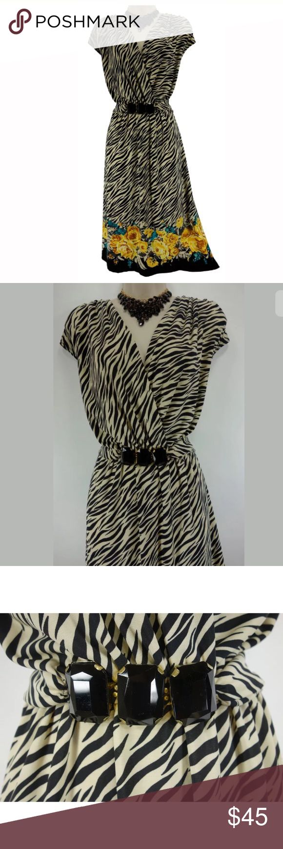 """16W 1X▪️GORGEOUS ZEBRA-FLORAL PRINT DRESS Plus Sz We LOVE this sexy, eye-catching, zebra-floral print summer dress!    Size: 16W Slip on/ slip off Surplice neckline  3 big, black jewels embellish the waist Eye-catching zebra-floral prints Stretchy, comfortable fabric  Measurements: Bust (armpit to armpit):  45"""" relaxed - stretches to 54"""" Waist: 38"""" relaxed - stretches to 46"""" Hips:  56"""" relaxed Length: 40.5"""" (top of shoulder to bottom hem)  Condition:  PRISTINE CONDITION! Fabric Content…"""