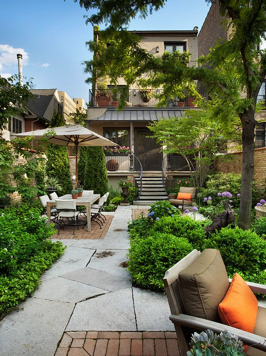 This small back yard looks like a quaint city park narrow for Small back garden ideas