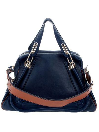 Sac en cuir bleu Chloé avec double anse détail boucles en métal argenté, bandoulière détachable contrastante marron, fermeture à glissière et poche zippée à l'intérieur.