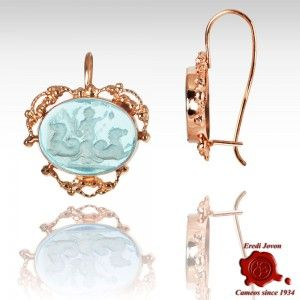 GLASS INTAGLIO CAMEO EARRINGS GOLDEN FILIGREE SET  Cameo earrings created engraving glass instead of conch or stones, set in golden filigree. The peculiar limpidity let you appreciate the precision of inlay. The subject depicts the chariot of Neptune, symbol of domination of the seas, allegory of Serenissima Republic of Venice's supremacy.  https://www.eredijovon.com/en/2686-glass-intaglio-cameo-earrings-golden-filigree-set.html