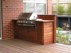 Idea for built-in BBQ Unit - could incorporate existing BBQ unit (sans wheels and side trays), using merbau timber decking timber to match flooring on verandah.