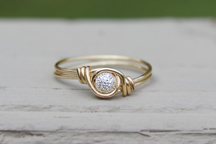 This wire wrap ring features a sparkly silver-plated stardust bead. Perfect for any occasion! The bead is delicately wrapped in the wire of your choice.