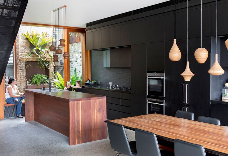 This kitchen, in a renovated Sydney worker's cottage, is 12 metres long, and features a grey ironbark island, and black granite bench tops. Photography: Brett Boardman | Styling: Danya Cameron | Story: Australian House & Garden