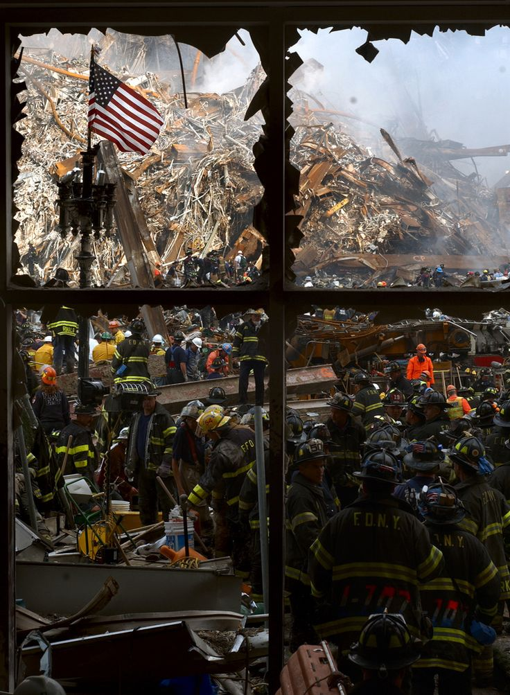 https://flic.kr/p/cF7Ae   WTC 9/11   New York, N.Y. (Sept. 14, 2001) -- New York City firemen walk past the American flag as they work their way toward the heart of the devastation that was once the World Trade Center.