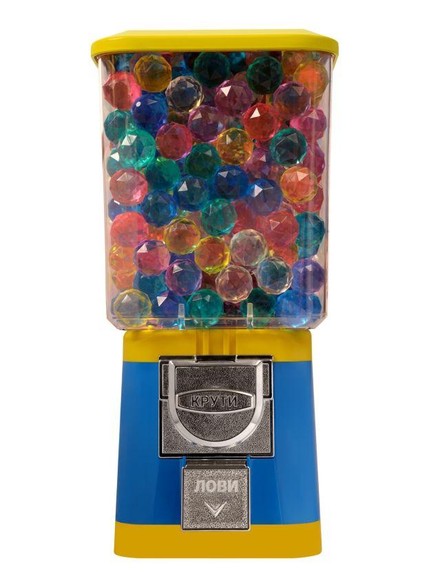Торговый автомат Стандарт компании Global Gumball предназначен для продажи игрушек в капсулах, мячей прыгунов, марблс, порционных конфет или жевательной резинки.