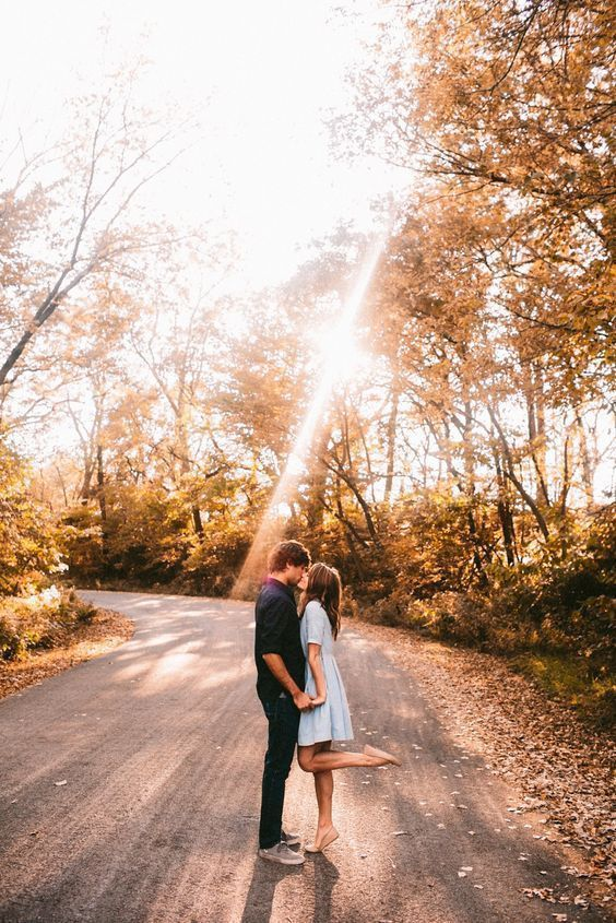 12 Cozy And Sweet Fall Engagement Photo Shoot Ideas: An amazing picture in a fall sunlight forest is very romantic