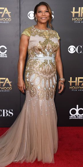 Red Carpet Style at the Hollywood Film Awards | QUEEN LATIFAH | The host of the awards show keeps all eyes on her thanks to a seriously embellished cap-sleeve gown complete with lots of metallic beading and a mini tulle train.
