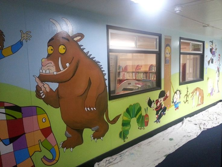 This large mural was painted on the interior walls surrounding this primary school library. It features a simple green and blue background so that we could spend lots of time adding many book characters from the pupils favorite books. This included Elmer, the Gruffalo, Horrid Henry, The hungry hungry caterpillar, room on the broom and Rapunzel. This is a great way to make children excited about reading and encourage them to visit the library.