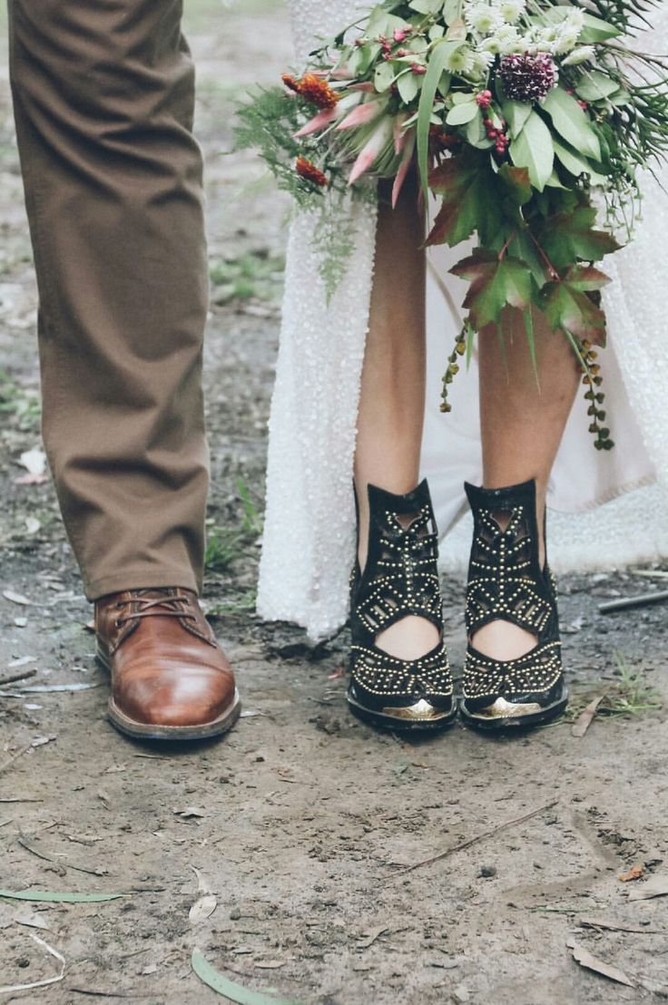Boots and bouquet. Flowers by @asdaisydoes