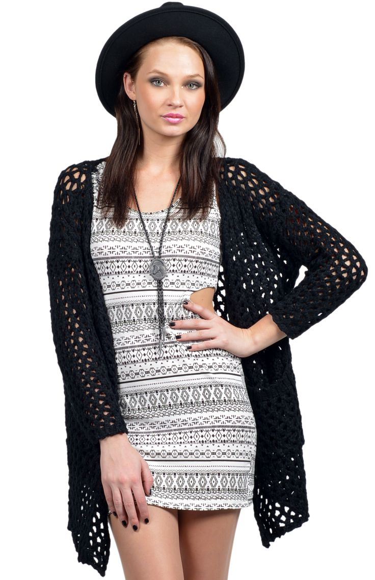 Chunky knitted cardigan in black featuring front pockets and open front. Team with a fitted cut out bodycon dress, bolo tie, wide brim hat and ankle boots for a chic, boho feel. Length: 64cm. Width: 56cm. Available online at www.ilovethelot.com