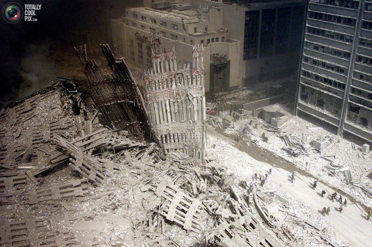 A group of firefighters walk amid the rubble near the base of the destroyed south tower of the World Trade Center in New York in this September 11, 2001 file photo. September 11th marks the 10th anniversary of the 9/11 attacks where nearly 3,000 people died when four hijacked airliners were used in coordinated strikes on the Pentagon and the World Trade Center towers. The fourth plane crashed in Pennsylvania. REUTERS/Peter Morgan/Files
