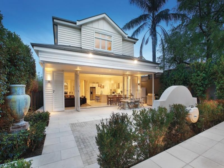 I love this weatherboard house and how it opens up to the back yard.