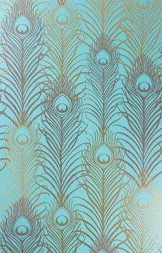 Plumes de paon dorées sur fond bleu