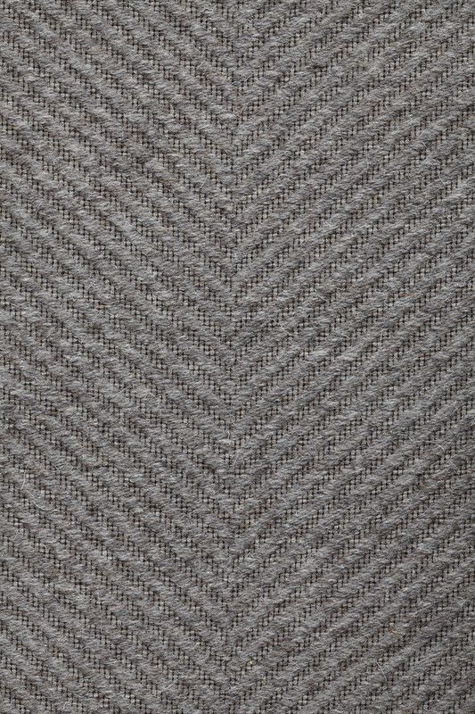 Harris in Dark Gray - Undyed Dark Gray - Customizable with all yarn colors. Harris makes an elegant foundation to any room with a classic herringbone weave of pure British wool. A flatweave rug made from undyed heathered wool, Harris is available in 5 rich colorways: Fawn, Loam, Light Gray, Dark Gray and Noir. Harris, Hawes & Co. was an innovative 19th-century machine manufacturer that served the booming Fall River textile industry.
