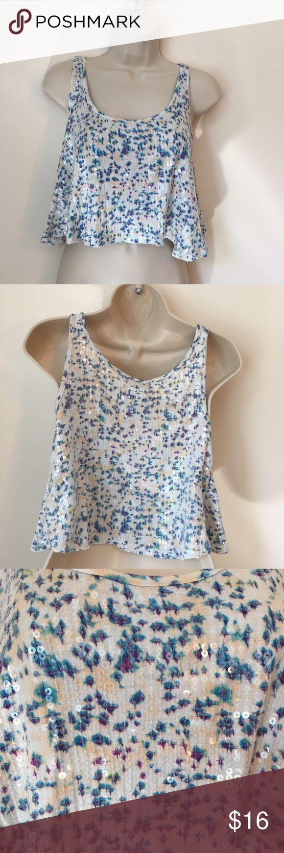 "Free people flowing  crop sequin tank top XS Free people oversized crop tank top.  Multicoloured, with purple, blue and cream and clear sequin. Preowned in good condition.  Measurements flat across; Chest:19""  Length:17"" Free People Tops Tank Tops"