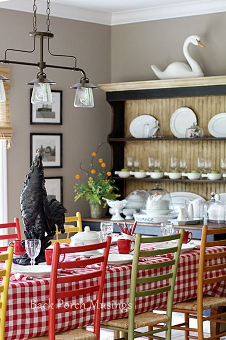 Farmhouse table and ladderback chairs. LOVE the different colors!
