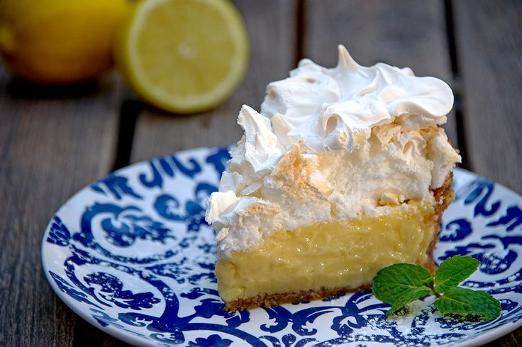 The very best lemon meringue pie... Thick dense lemon curd layered with light, floaty, meringue on a crumbly buttery biscuit base #heaven #lemon #CafeParadiso #cake #dessert #meringue