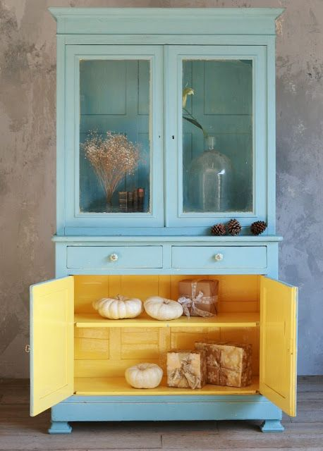 An adorable 1930's vintage cabinet painted in aqua and on the inside, it's painted a glossy yellow. Love this!