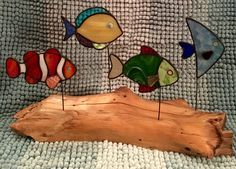 Stained glass fish on driftwood