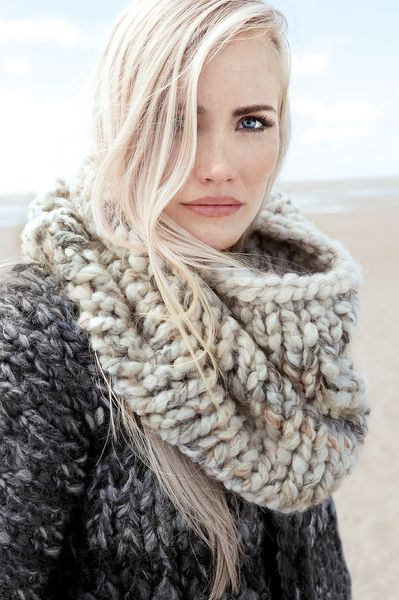 I love this scarf. I could knit one if I could be bothered. But I can't. Certainly don't have the face above it either. So dream on.