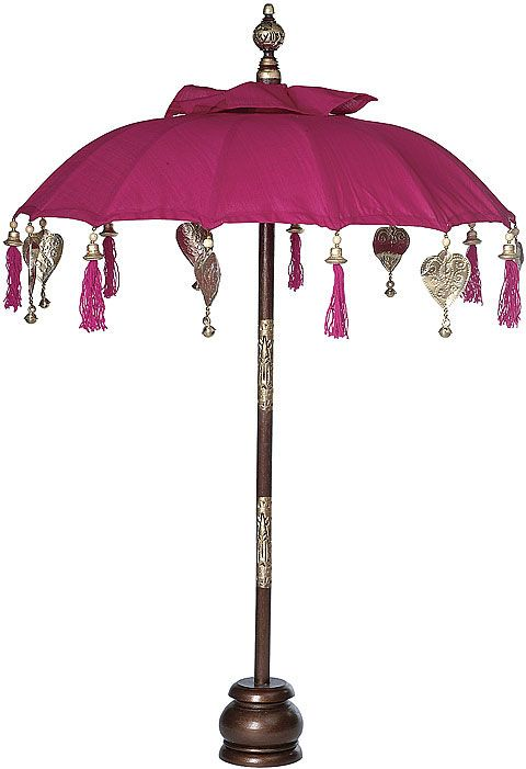 Fuchsia Balinese Festival Parasol decorated with bells, tassels, and gilded hearts.
