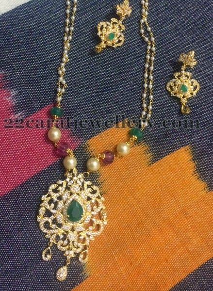 Imitation Pearls Set with Green CZ Locket | Jewellery Designs