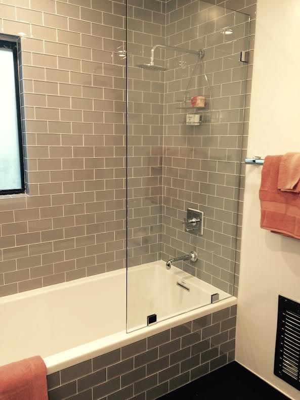 Amazing Use Of The Smoke Glass Subway Tile In Shower Surround And Tub Front