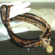 CLICK HERE TO BUY:   https://www.etsy.com/listing/112147962/ashira-black-spinel-and-natural    Ashira Black Spinel and Natural Hessonite Garnet Gemstone Necklace with Charms, $445.00, Trish Regan