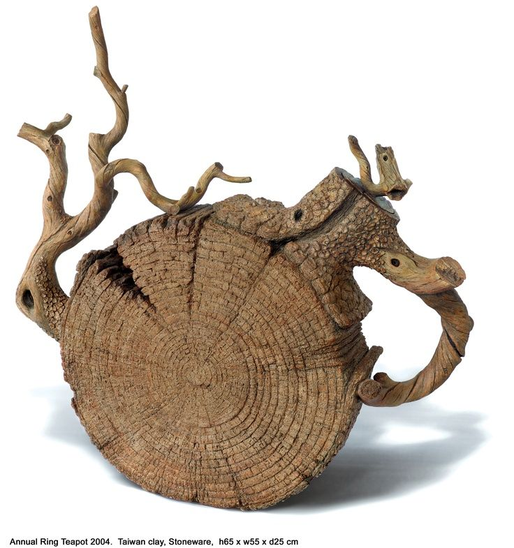 ceramic teapot by Ah Leon. Looks like a sliced tree limb. Cool...I'll use this when I invite Johnny Depp and Helena Bonham Carter to tea, said Georganna Louise. Tea Time board