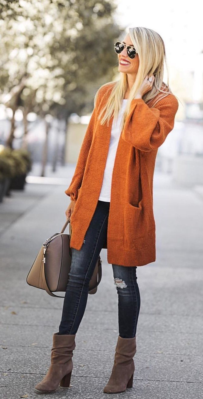 #fall #outfits women's brown knitted open cardigan, white shirt, distressed blue denim jeans, with pair of brown suede heeled mid calf boots outfit