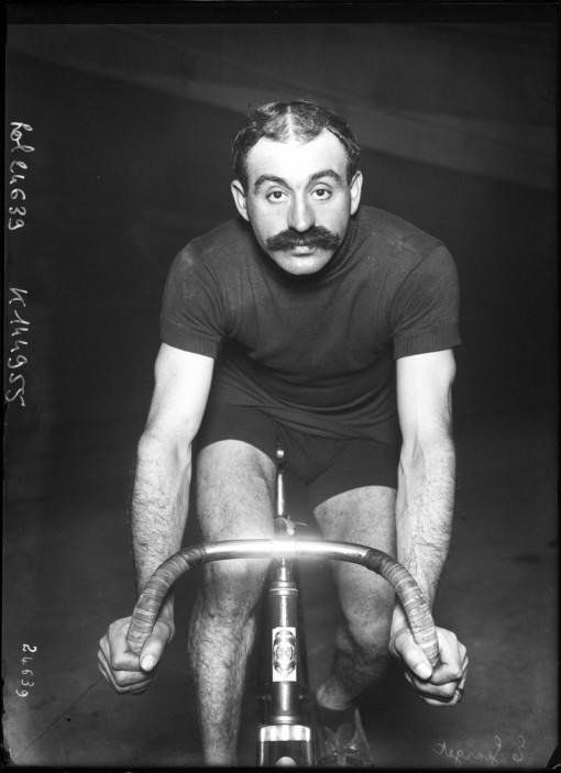 I love this photo - super cool bike!  Early racing cyclist.