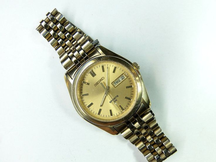 "The clear genuine crystal has a few scratches which may not show in the photos showing the flawless face to read ""SEIKO, Sports 50, mov't Japan 7N43-8H98 HR 2 [at bottom]"" and the screw-down back should be visible to read in the photos. 