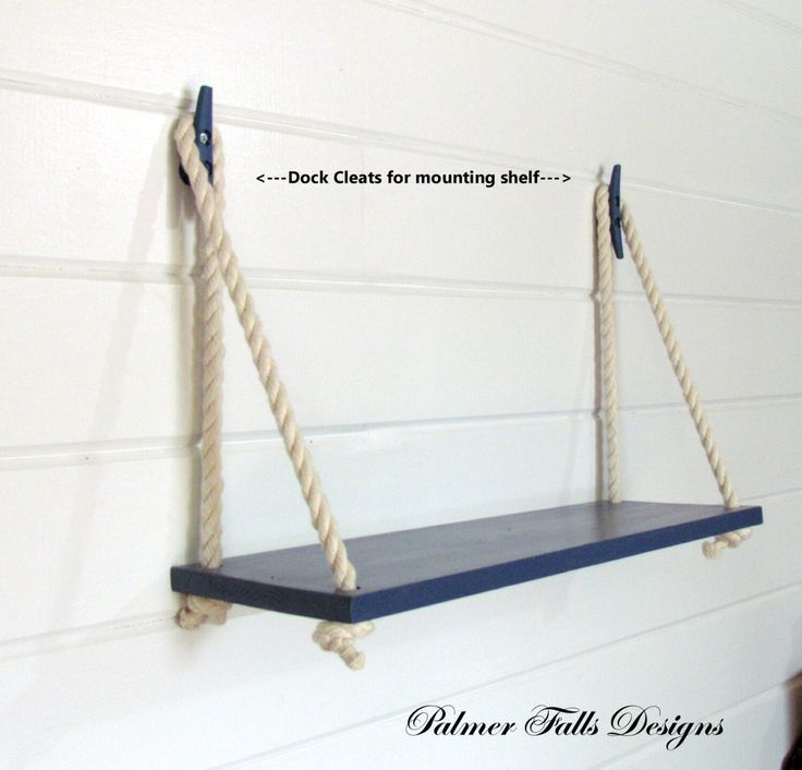 Rope and a dark rustic shelf with white towels for kids bathroom!