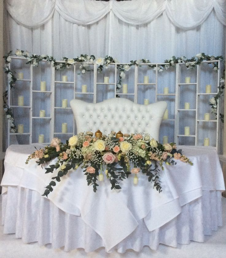 Wall of candles by cathey's flowers