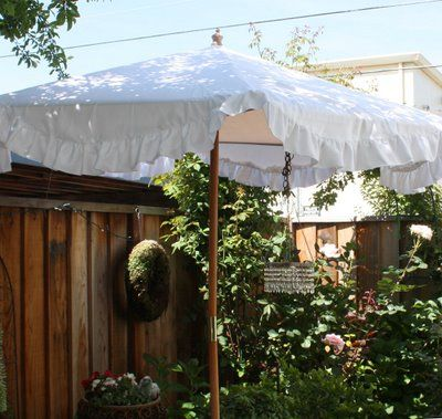 ruffled patio umbrella- A no-sew option would be to look for a round tablecloth - I see them up to 90 inches round at TJ Maxx and Marshalls fairly often. cute inspiration blog - thanks, anonymous!  Monica in PA