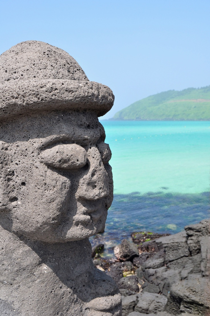 """Dol Harubang (translated means """"stone senior,"""" but in the Jeju dialect means…"""