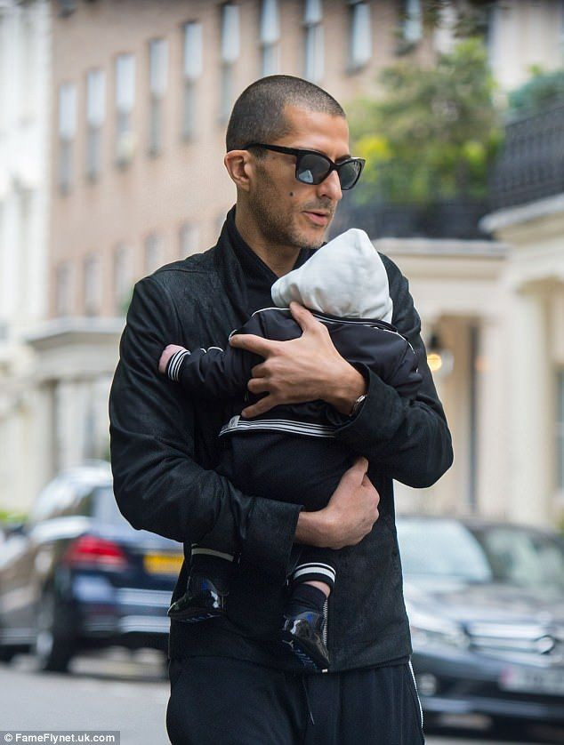 Besotted: Business magnate Wissam Al Mana looked as besotted as ever with his son Eissa on Monday as he took the tot for a stroll around London
