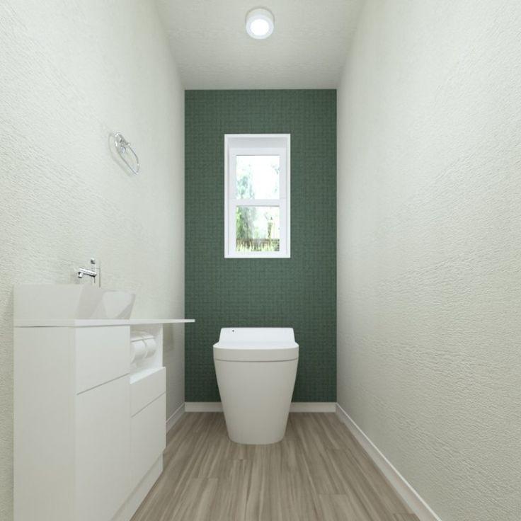 ホワイトとモスグリーンでシンプルにまとめました。清潔感のあるトイレです。
