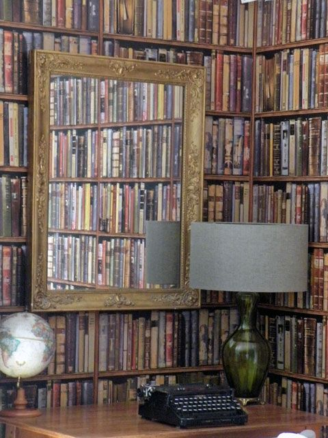 Andrew Martin Wallpaper creates an interesting Library corner.  Interior Design by Room Service Interiors.