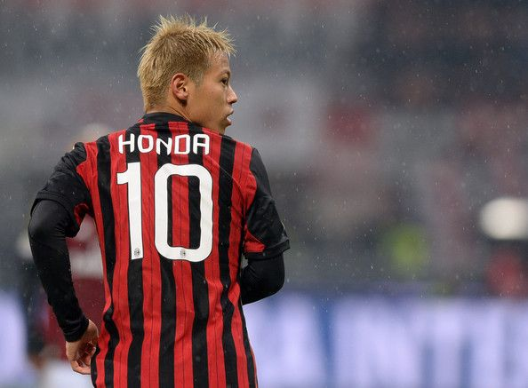 Keisuke Honda Photos Photos - Keisuke Honda of AC Milan during the Serie A match between AC Milan and Hellas Verona FC at San Siro Stadium on January 19, 2014 in Milan, Italy. - AC Milan v Hellas Verona FC - Serie A