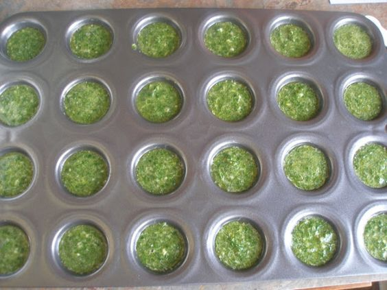 How to freeze cilantro - Instead of freezing it in ice cube trays, use a mini muffin tin so the amounts will be smaller and use it like a garnish, as you would fresh cilantro.