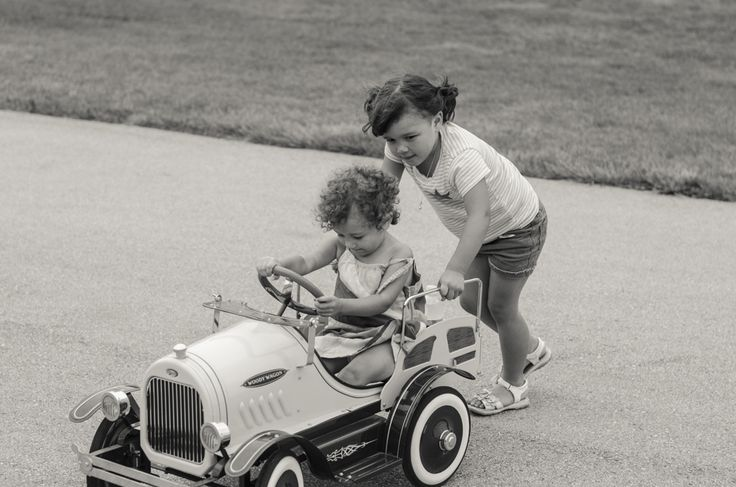 sisters in pedal car modern storytelling lifestyle photography | Erin Hall Photography Hamilton ON
