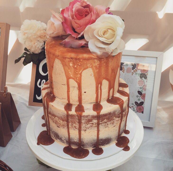 Caramel & floral drip cake. #babyshower #cake #floral #caramel #rustic #decorations #flowers