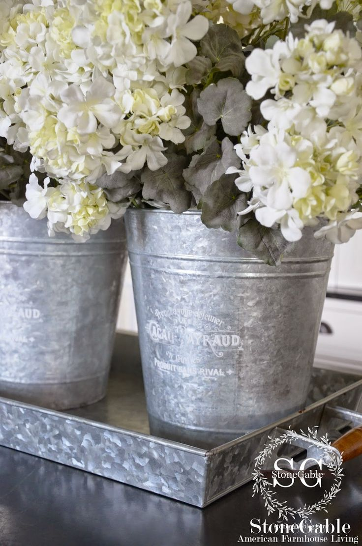 **1**Detail of the galvanized buckets and tray on the kitchen island