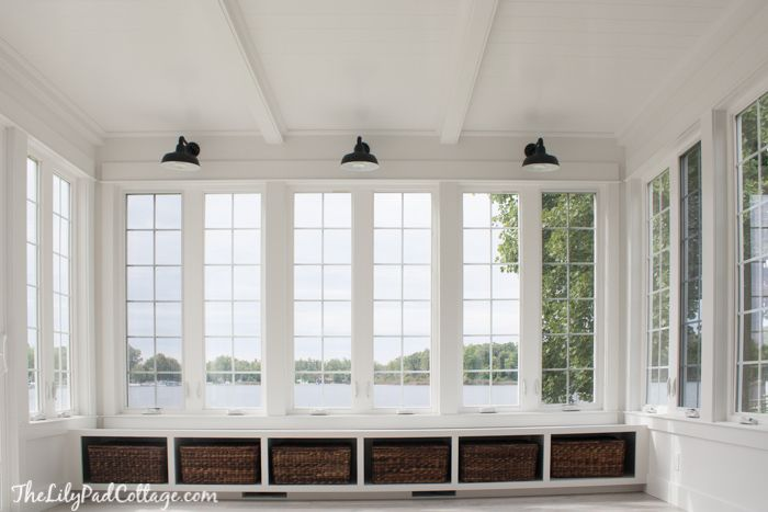 Everything about this white + airy sunroom is perfection! // thelilypadcottage.com